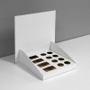 Custom cardboard counter display with inserts for small bottles - front view, white