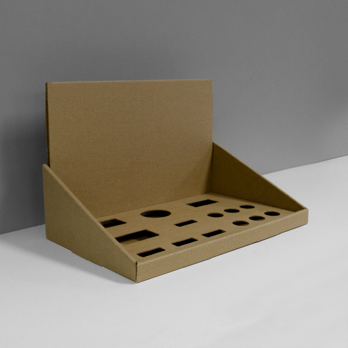 Cardboard counter display with multiple inserts and header - kraft