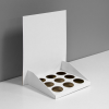 Cardboard counter display with custom inserts for small bottles and header - white