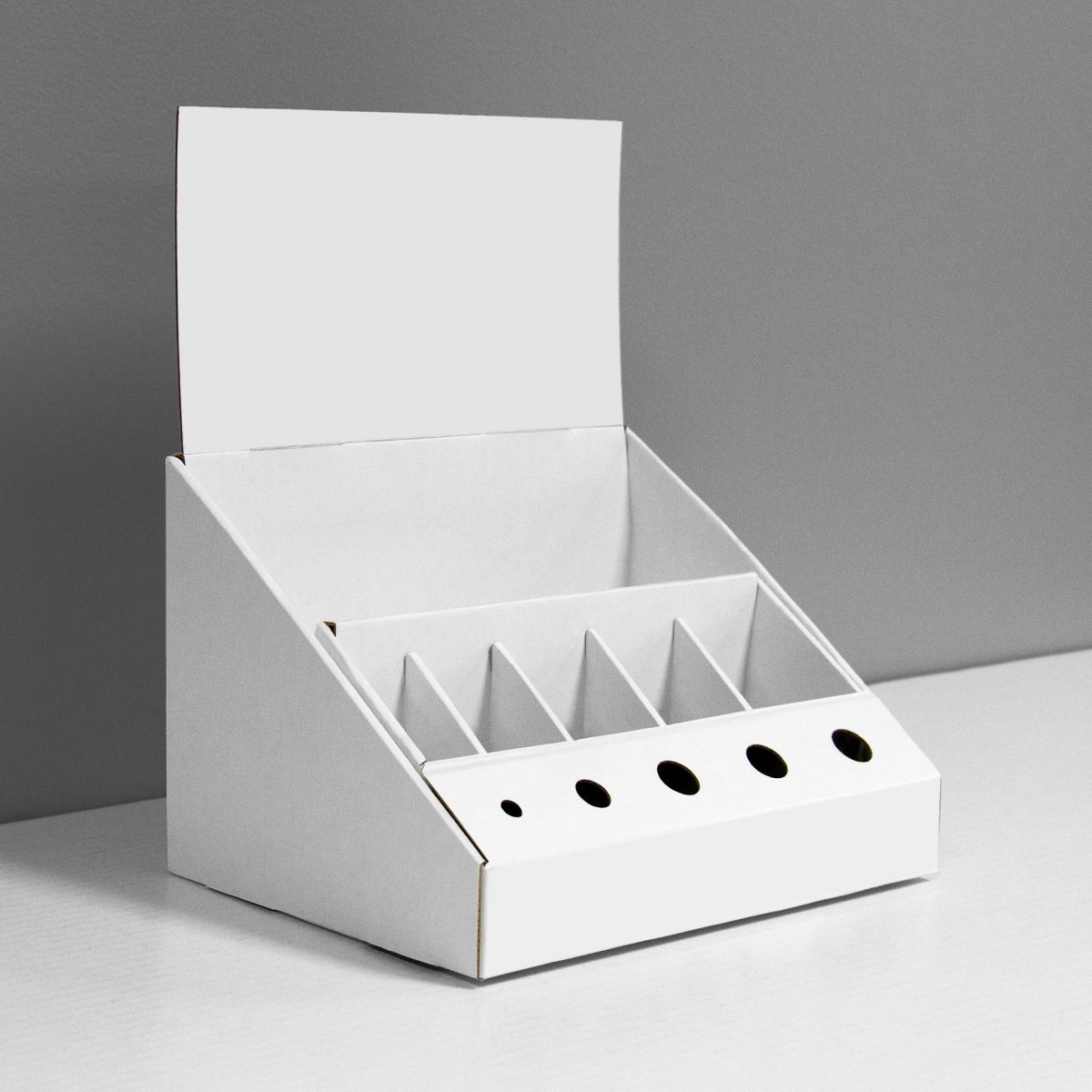 Cardboard counter display with custom inserts and header - white
