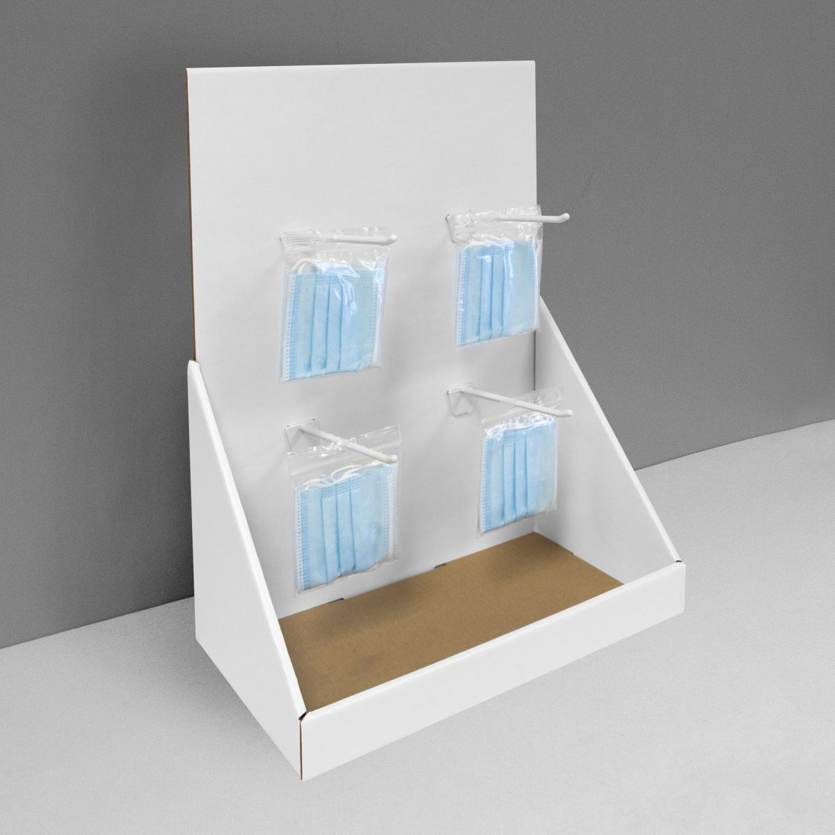 Cardboard counter display with 4 pegs/hooks for face masks - covid-19 face mask - white
