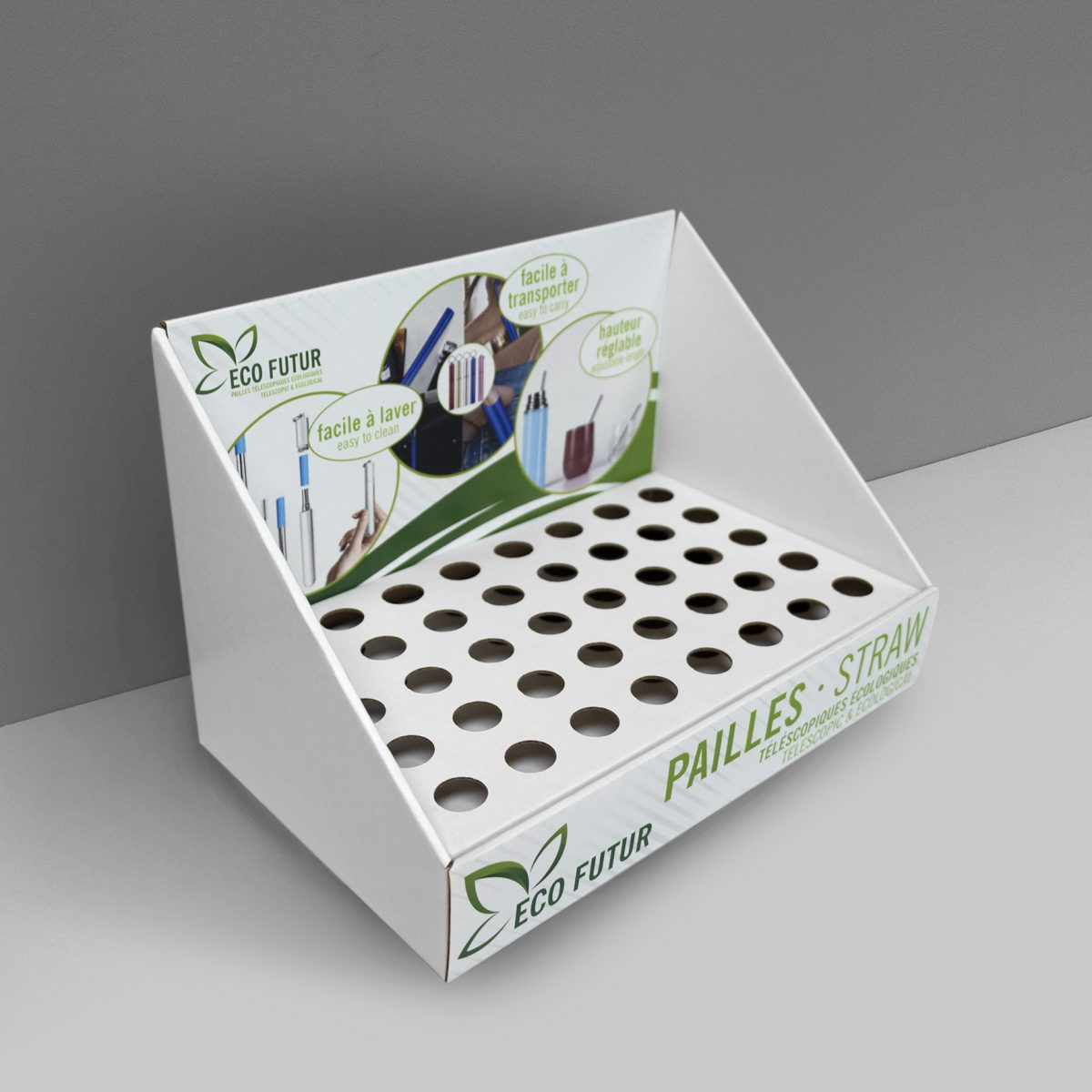 Angled Cardboard counter display with multiple small slots/holes to hold cylindric products - printed