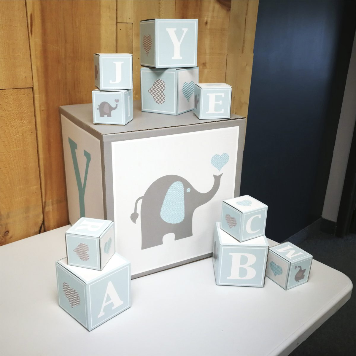 Custom cardboard cubes for baby shower decorations - photo