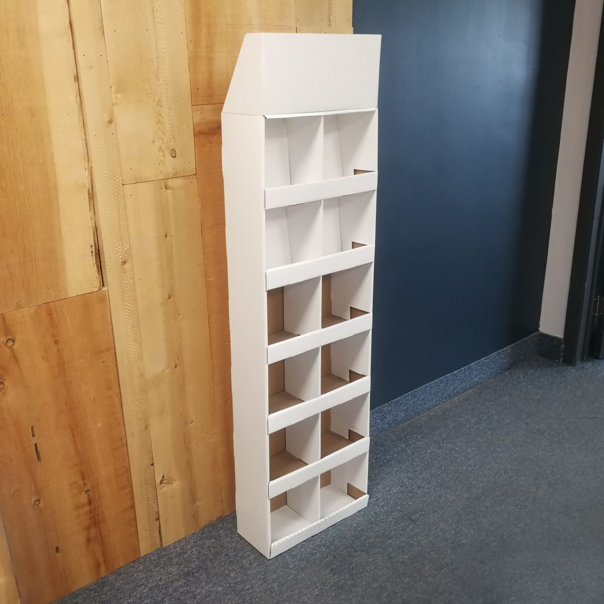 Cardboard Sidekick designed to be wall mounted, with 5 shelves and a separator in the middle (12 slots) and an optional header - white